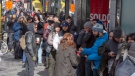 Customers lineup at a government cannabis store Thursday, October 18, 2018 in Montreal on the second day of the legal cannabis sales in Canada. THE CANADIAN PRESS/Ryan Remiorz