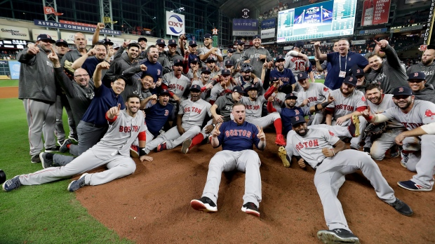 The Boston Red Sox pose for a picture after winning the baseball American  League Championship Series against the Houston Astros on Thursday 1c3cbb46d