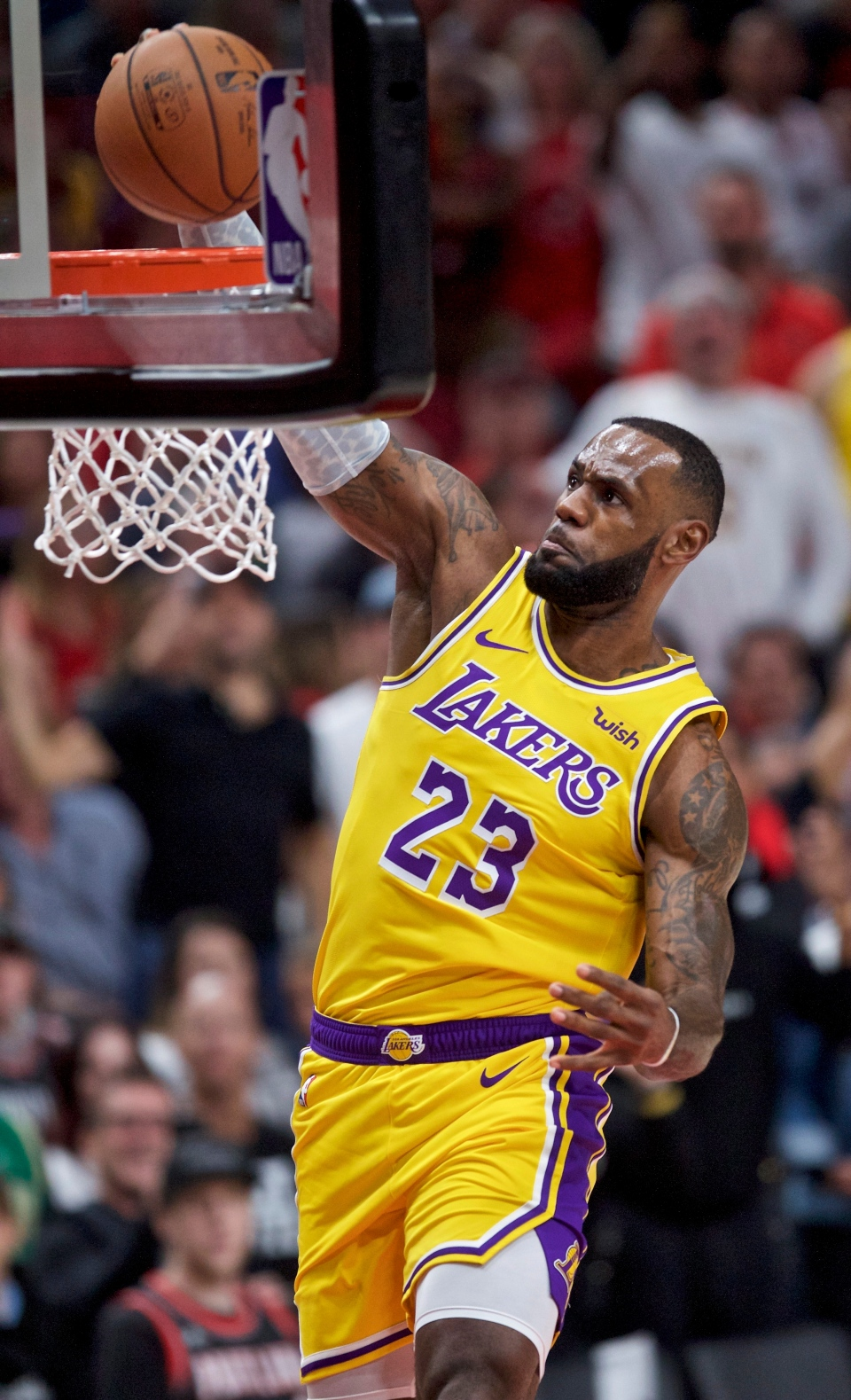 f15a466d5d1 Los Angeles Lakers forward LeBron James dunks against the Portland Trail  Blazers during the first half of an NBA basketball game in Portland, Ore.,  ...
