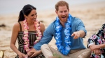 Prince Harry and Meghan, Duchess of Sussex meet with a local surfing community group, known as OneWave, raising awareness for mental health and wellbeing in a fun and engaging way at Bondi Beach in Sydney, Australia, Friday, Oct. 19, 2018. (Dominic Lipinski/Pool via AP)