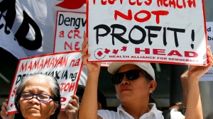 In this Monday, March 5, 2018 file photo, protesters display placards during a rally at the Sanofi Pasteur office in suburban Taguig city to protest the drug company's deal with the Government on the controversial anti-dengue vaccine Dengvaxia, in the east of Manila, Philippines. (AP Photo/Bullit Marquez, File)