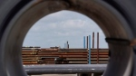 Steel pipes are seen through a roll of steel at the Borusan Mannesmann Pipe manufacturing facility in Baytown, Texas on June 5, 2018. (AP Photo/David J. Phillip, File)