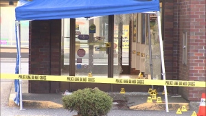 A CIBC bank in Abbotsford remains cordoned off with police tape the morning after a deadly shooting.