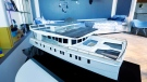 A model of the 74-foot Neiman Marcus Serenity Solar Yacht is displayed during a preview of the Neiman Marcus Christmas Book in New York, Thursday, Oct. 18, 2018. (AP Photo/Richard Drew)