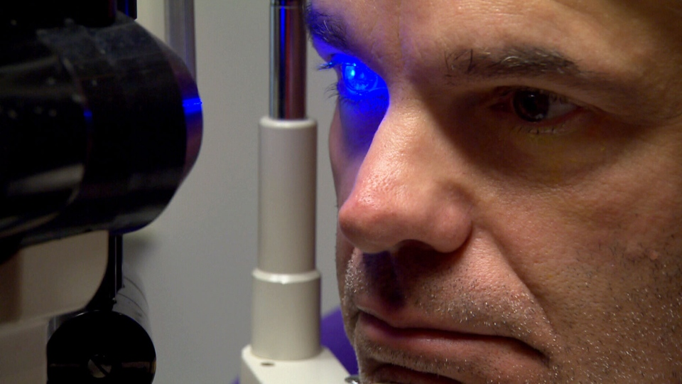 A patient of ophthalmologist and cornea specialist Dr. Pedram Hamrah at a clinic at Tufts Medical Center in Boston (W5).