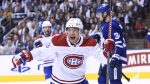 Montreal Canadiens left wing Max Domi celebrates a goal by teammate Artturi Lehkonen against the Toronto Maple Leafs during first period NHL hockey action in Toronto on Wednesday, October 3, 2018. THE CANADIAN PRESS/Nathan Denette