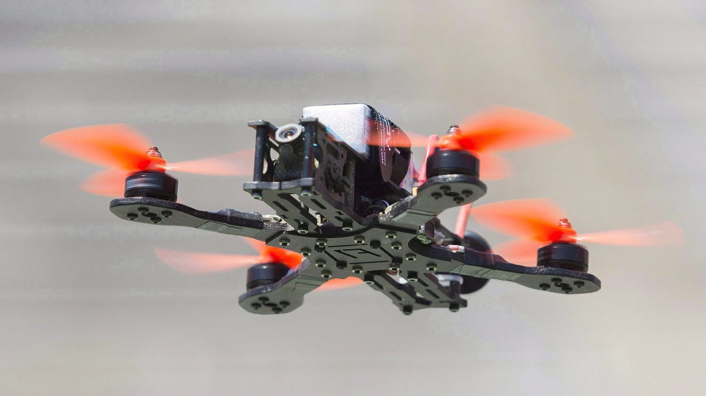Woman changing in her bedroom sees drone hovering outside her window