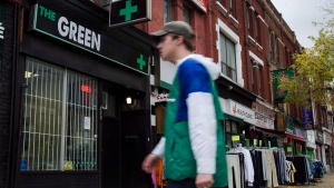 People walk past a cannabis dispensary in Toronto on Monday, October 15, 2018. (THE CANADIAN PRESS/Christopher Katsarov)