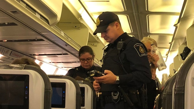Canada Border Services agents boarded the plane after it landed Bagotville, Quebec. (Courtesy Harrison Hove)