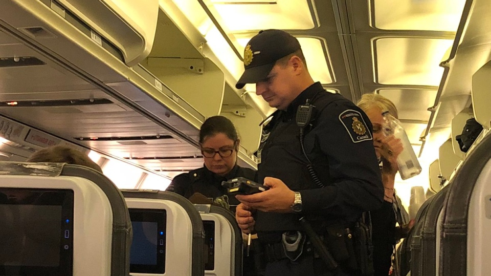 Canada Border Services agents boarded the plane after it landed Bagotville, Quebec. (Courtesy Harrison Hove / wuft news)