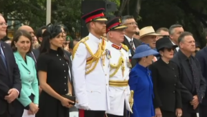 Prince Harry and his wife Meghan paid tribute to Australian service members by opening a new wing of a war memorial on Saturday.