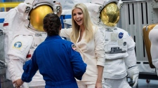 Astronaut Nicole Mann, left, talks to Ivanka Trump about a line of space suit as Mann gives her a tour of the Space Vehicle Mockup Facility during a visit to NASA's Johnson Space Center on Thursday, Sept. 20, 2018, in Houston. (Brett Coomer/Houston Chronicle via AP)