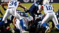 Toronto Argonauts quarterback James Franklin (2) pushes against the Montreal Alouettes defence to score a rushing touchdown during second half CFL football action, in Toronto on Saturday, Oct. 20, 2018. THE CANADIAN PRESS/Cole Burston