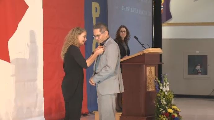 Governor General Julie Payette presents Bob Kayseas with a Meritorious Service Medal in Regina on Oct. 20, 2018.