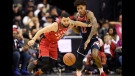 Toronto Raptors guard Fred VanVleet (23) chases the loose ball against Washington Wizards forward Kelly Oubre Jr. (12) during the second half of an NBA basketball game, Saturday, Oct. 20, 2018, in Washington. The Raptors won 117-113. (AP Photo/Nick Wass)
