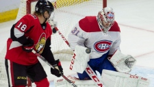 Montreal Canadiens goalie Carey Price makes a save as Ottawa Senators left wing Ryan Dzingel tries to tip the puck during first period NHL action in Ottawa on Saturday, Oct. 20, 2018. THE CANADIAN PRESS/Adrian Wyld