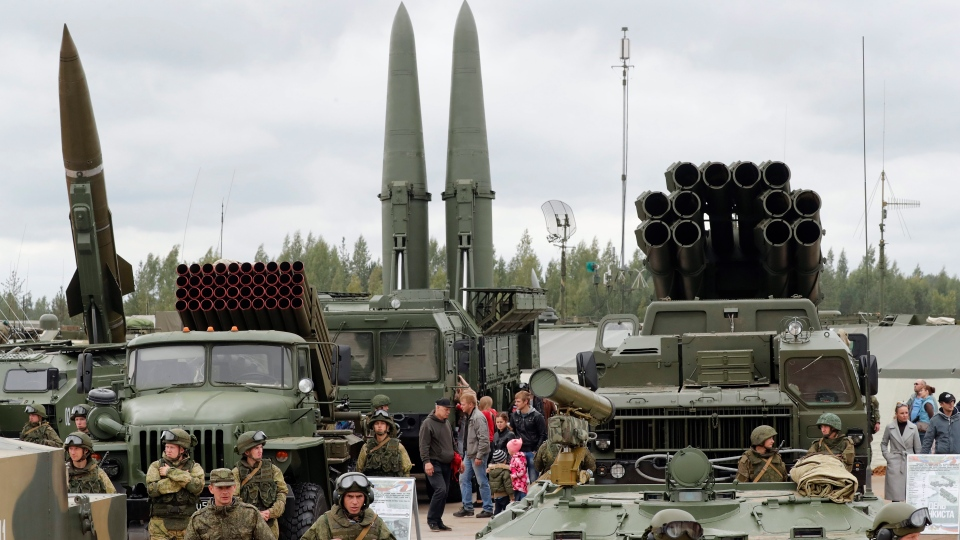 File photo of visitors look at Russian tactical ballistic missile OTR-21 Tochka-U (L), 122mm multiple rocket launcher BM-21 Grad (2_L), tactical ballistic missile 9K720 Iskander-M (C) and 300mm multiple rocket launcher BM-30 Smerch (R) during a military exhibition marking the Tank's Day on a tank range in Luga, outside St. Petersburg, Russia, 09 September 2017 (reissued 20 October 2018).
