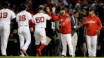 Members of the Boston Red Sox celebrate after their 7-5 win against the Houston Astros in Game 2 of a baseball American League Championship Series on Sunday, Oct. 14, 2018, in Boston. (AP Photo/Charles Krupa)