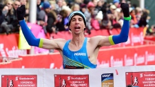 Cameron Levins arrives at the finish line of the 2018 Scotiabank Toronto Waterfront Marathon. (Canadian Running Series / Twitter)