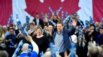Conservative leader Andrew Scheer waves to supporters as his wife Jill joins him on stage, following a pre-election event in Ottawa on Sunday, Oct. 21, 2018. THE CANADIAN PRESS/Justin Tang