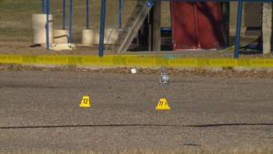 """Evidence markers and crime scene tape were seen Sunday at the Royal Gardens Community League, where police were investigating a """"suspicious death."""""""