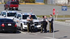 Emergency crews waiting for the five people on board the helicopter at the Pitt Meadows airport.
