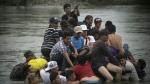 Migrant caravan grows with determination
