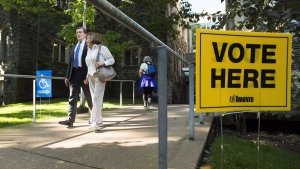 Toronto Mayor John Tory accompanies his mother Elizabeth Tory to vote at an advanced polling election station in Toronto on Oct. 10, 2018. (Nathan Denette / THE CANADIAN PRESS)