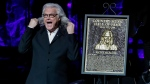 Ricky Skaggs accepts his plaque at the 2018 Medallion Ceremony at the Country Music Hall of Fame and Museum on Sunday, Oct. 21, 2018, in Nashville, Tenn. (Photo by Al Wagner/Invision/AP)