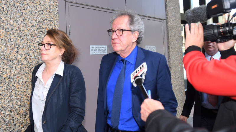 Australian actor Geoffrey Rush, centre, leaves the Federal Court in Sydney, Australia, on Oct. 22, 2018. (Dean Lewins / AAP Image via AP)