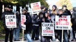 Canadian Union of Postal Workers (CUPW) members stand on picket line along Almon St., in front of the Canada Post regional sorting headquarters in Halifax on Monday, Oct.22, 2018 after a call for a series of rotating 24-hour strikes. THE CANADIAN PRESS/Ted Pritchard