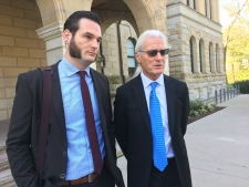 Journalists John and Brett Hueston speak to media after being found not guilty of obstructing justice on Monday, Oct. 22, 2018. (Brent Lale / CTV London)