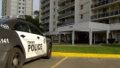 A police cruiser sits outside a Scarborough building where police say an assault occurred, resulting in the death of a three-week-old baby girl.