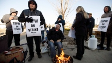 Canada Post workers picket after going on strike in Edmonton, on Monday, Oct. 22, 2018. THE CANADIAN PRESS/Jason Franson