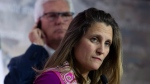 Canada's Minister of International Trade Diversification Jim Carr looks on as Canada's Minister of Foreign Affairs Chrystia Freeland listens to a questions during a news conference in Ottawa, Monday October 22, 2018. THE CANADIAN PRESS/Adrian Wyld