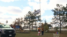 Village lowers 'straight pride' flag after outrage