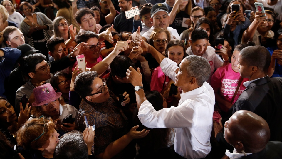 Former President Barack Obama meets with people at a rally in support of candidate for Senate Jacky Rosen and other Nevada Democrats, Monday, Oct. 22, 2018, in Las Vegas. (AP Photo/John Locher)