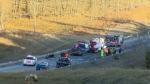 Emergency crews remain on scene of a fatal crash along Highway 22 near Priddis