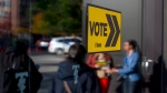 Voters line up outside a voting station to cast their ballot in the Toronto's municipal election in Toronto on Monday, October 22 , 2018. (THE CANADIAN PRESS/Chris Young)