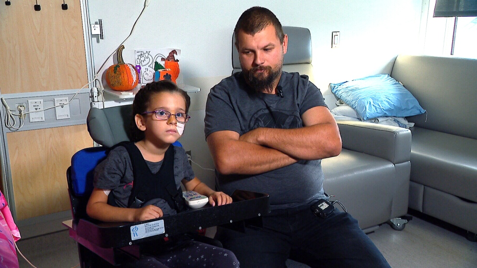 Four-year-old Genevieve Blais is currently being treated for acute flaccid myelitis at the Montreal Children's Hospital. She is pictured with her father, Nicolas Blais. (CTV News)   , who is currently receiving treatment at the Montreal Children's Hospital.