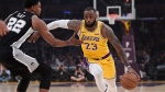 Los Angeles Lakers forward LeBron James, right, drives toward the basket as San Antonio Spurs forward Rudy Gay defends during the first half of an NBA basketball game Monday, Oct. 22, 2018, in Los Angeles. (AP Photo/Mark J. Terrill)