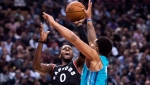 Toronto Raptors forward CJ Miles (0) shoots over Charlotte Hornets forward Miles Bridges (0) during second half NBA basketball action in Toronto on Monday, October 22, 2018. THE CANADIAN PRESS/Nathan Denette