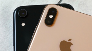 This Monday, Oct. 22, 2018, photo shows the iPhone XR, left, that has a single lens, and the iPhone XS Max that has two lenses, in New York. (AP Photo/Richard Drew)