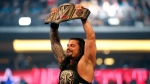In this April 3, 2016, file photo, Roman Reigns holds up the championship belt after defeating Triple H during WrestleMania 32 at AT&T Stadium in Arlington, Texas. (Jae S. Lee/The Dallas Morning News via AP, File)