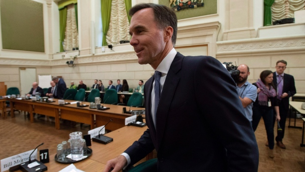 Finance Minister Bill Morneau arrives at the Standing Committee on International Trade on Parliament Hill in Ottawa, Tuesday October 16, 2018. THE CANADIAN PRESS/Adrian Wyld