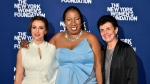 This Oct. 15, 2018 photo released by the New York Women's Foundation shows, from left, actress and activist Alyssa Milano, founder of the Me Too movement Tarana Burke and Ana Oliveira at The New York Women's Foundation's 2018 Radical Generosity gala in New York. (Annie Watt/The New York Women's Foundation via AP)