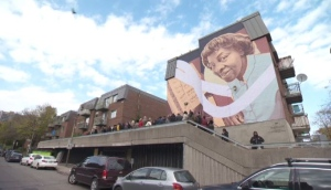 The new Daisy Peterson Sweeney mural is on Saint-Jacques St. east of Guy St.