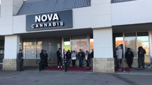 Dozens of customers lined up outside of Nova Cannabis on 80 Ave. and 104 St. in Edmonton before the store opened on Oct. 17, 2018.