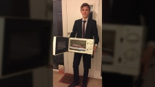 U.K. teen Jacob Ford carried his school materials in a microwave to protest his high school's ban on carrying backpacks in the hallways. (Courtesy of Jacob Ford)