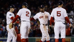 Boston Red Sox players celebrate after Game 1 of the World Series baseball game against the Los Angeles Dodgers Tuesday, Oct. 23, 2018, in Boston. The Red Sox won 8-4 to take a 1-0 lead in the series. (AP Photo/Matt Slocum)